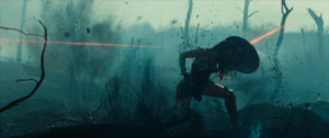 Diana deflects bullets as she crosses No-Mans' land.